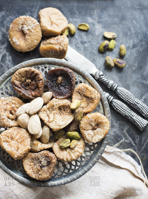 Dried figs and nuts served on an antique plate