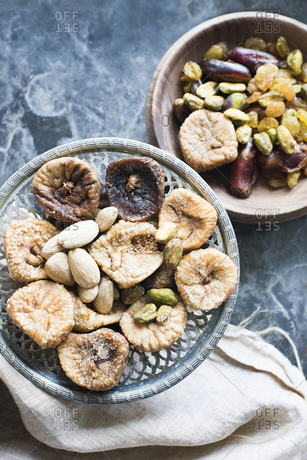 Two bowls of dried fruit