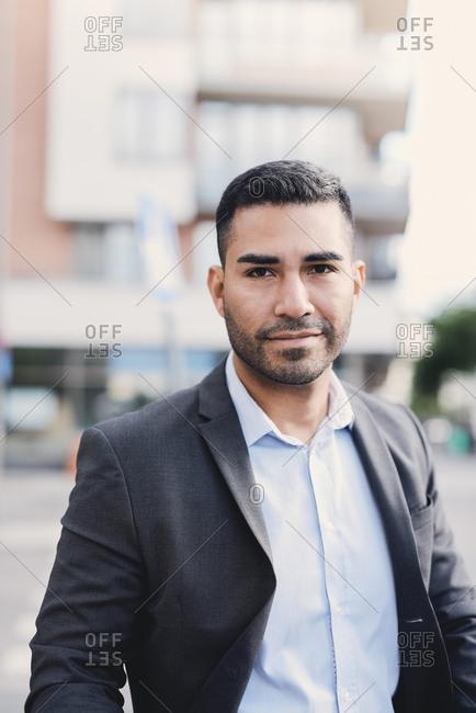 Portrait of confident businessman in city