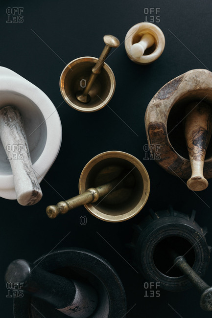 Variety of mortar and pestles on dark background