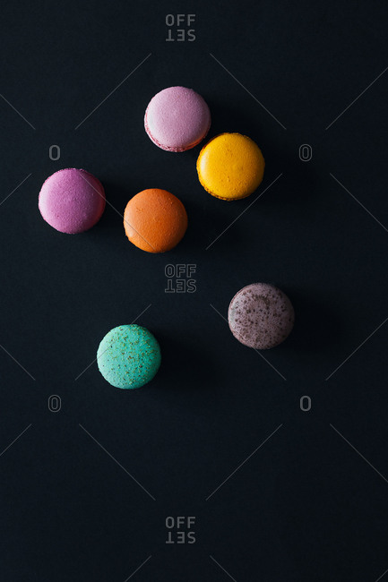 Bright colored macaroons on a black background