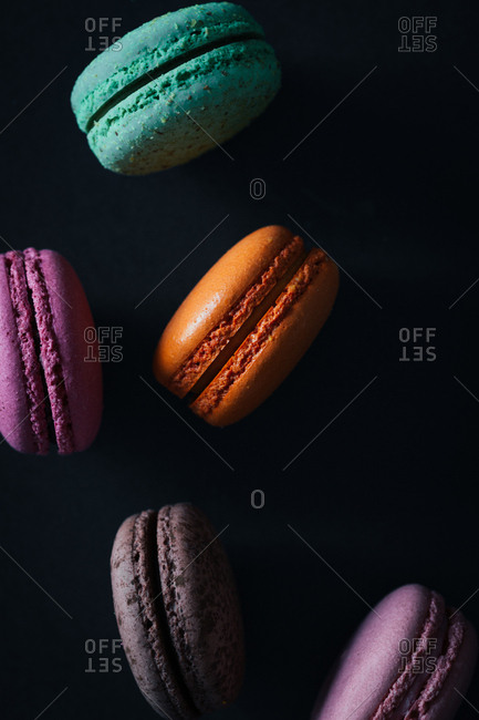 Colorful macaroons on a black background