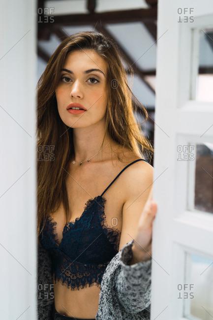 Charming woman posing in window