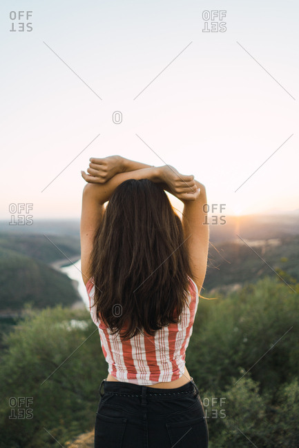 Cheerful woman in bright light on nature