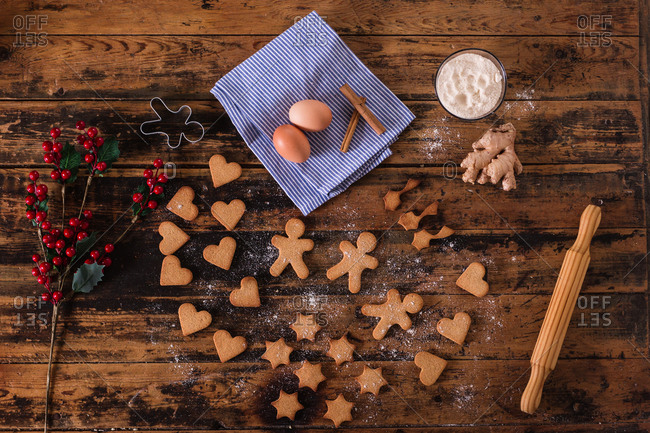 top view of gingerbread christmas cookies and ingredients for recipe on wooden table