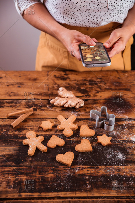 anonymous blogger photographing christmas food with a mobile phone