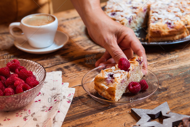 anonymous woman holding a slice of cake with her hand- christmas scene