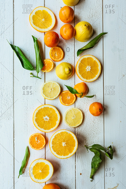 Sliced citrus fruits on a wooden background
