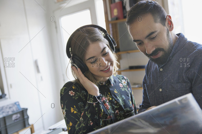 Young couple shopping for records together