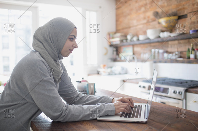 Muslim businesswoman working from home on her laptop