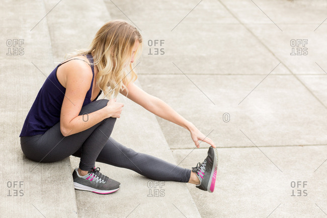 Woman stretching her legs before a workout