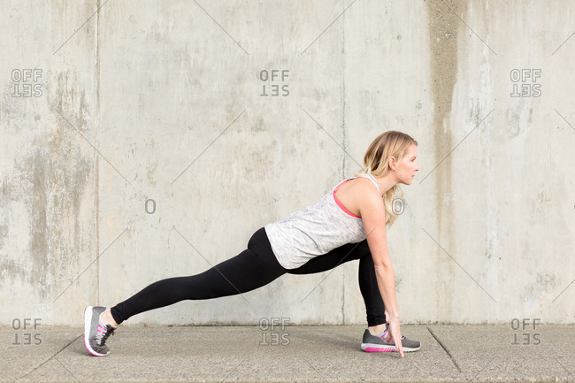 Blonde woman in a deep lunge