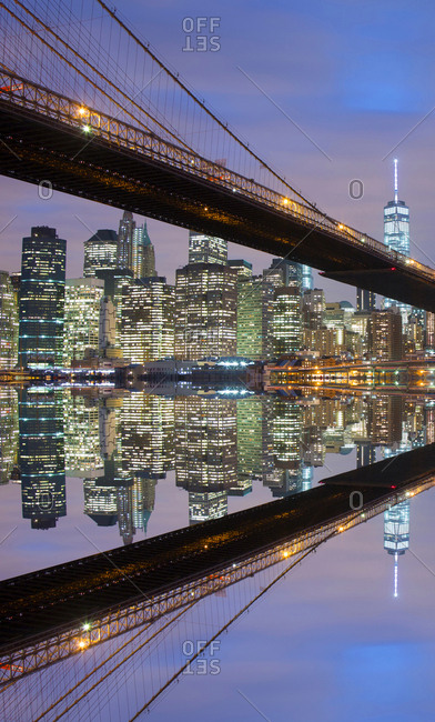 Brooklyn Bridge and the Manhattan skyline reflected in the East River