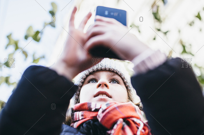 Girl taking selfie with phone