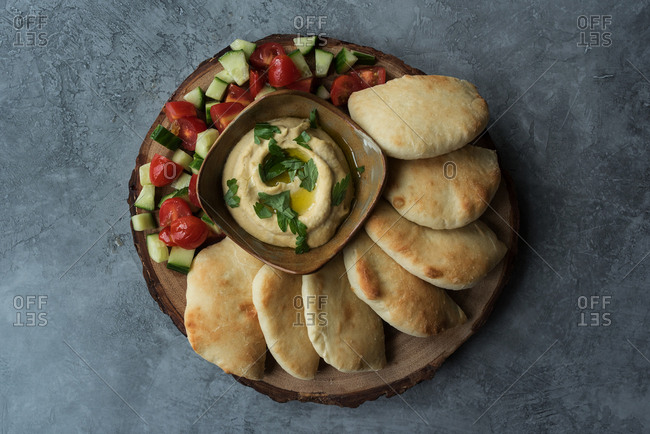 Hummus with pita bread appetizer