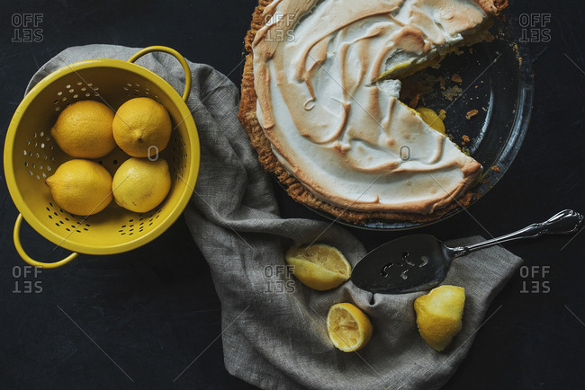 Lemon meringue pie and fresh lemons