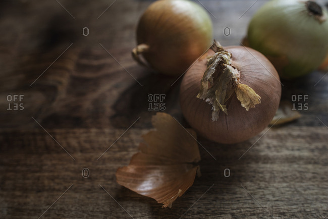 Yellow onions on a wooden table