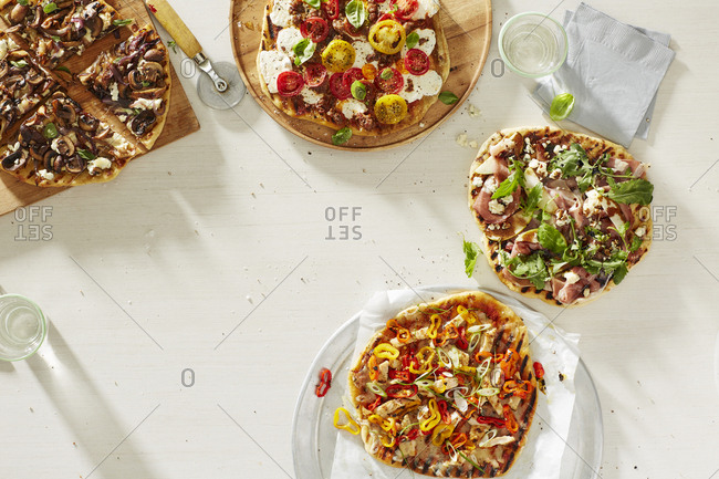 Overhead view of a variety of pizzas