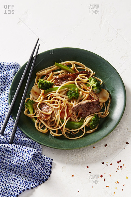 Beef broccoli lo mein with chopsticks