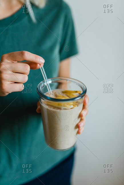 Woman drinking a pear smoothie
