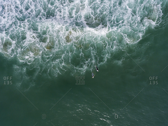 Aerial view of surfers surfing