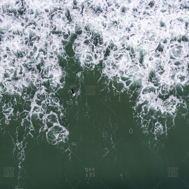 Aerial view of a surfer surfing