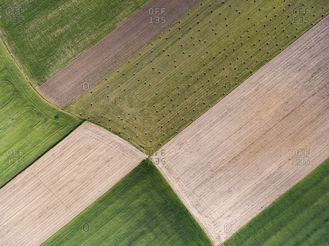 Aerial view of farmland with hay bales