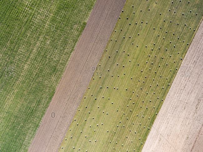 Aerial view of farm field with hay bales