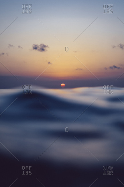 Ocean waves and sunset off the coast of Bali