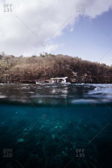Bali, Indonesia - November 28, 2017: Boat with tourists and underwater view on coast