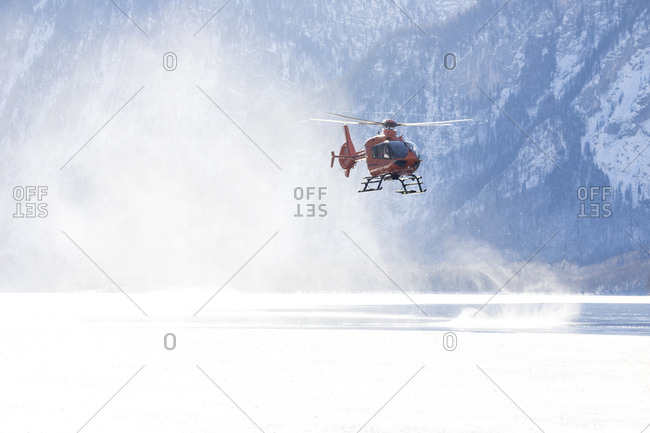 Germany- Berchtesgadener Land- flying helicopter over frozen Lake Koenigssee