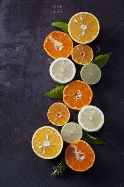 Halved lemons- limes- tangerines and oranges