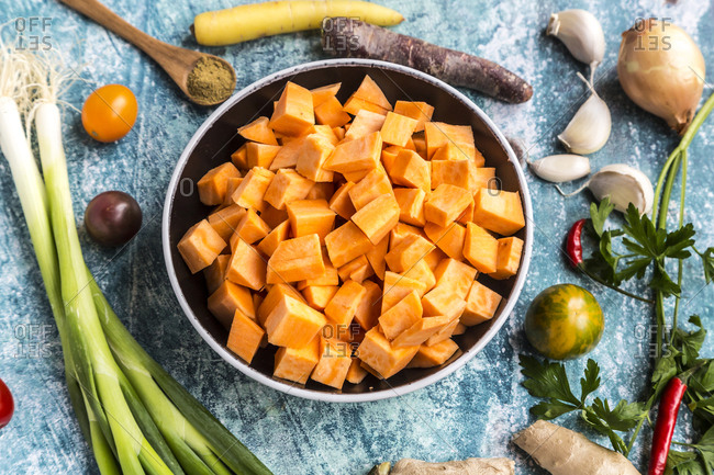 Ingredients for sweet potato soup with carrots- tomatoes- leek- garlic- parsley and cumin