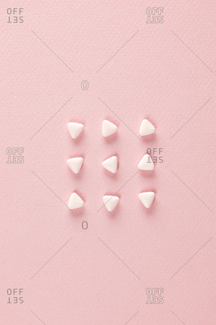 Pink pills with triangle shapes