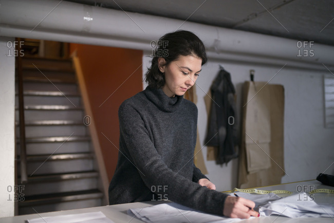 Fashion designer drawing a design in her workshop
