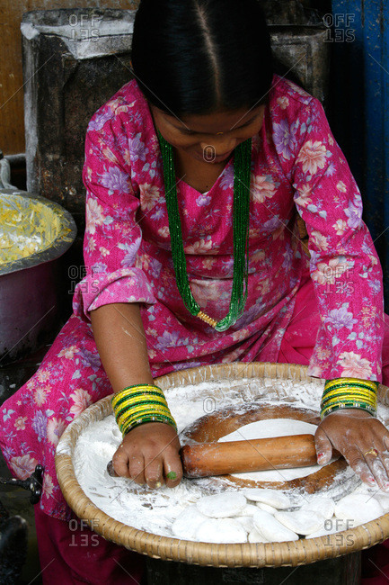 July 21, 2007: Woman preparing small cakes of bread in Nepal