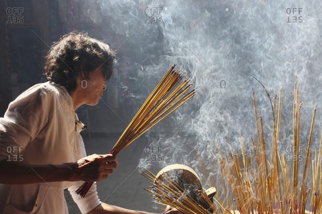 August 14, 2010: Quan Am Pagoda Burning Incense during Tet, the Vietnamese lunar New Year celebration, Saigon, Vietnam.