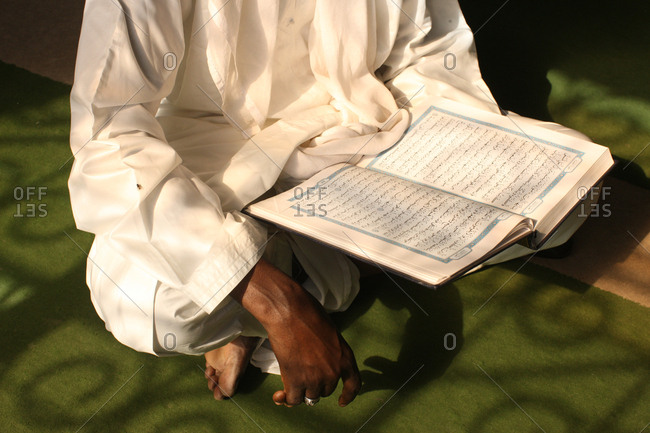 January 28, 2011: Imam reading the Coran.
