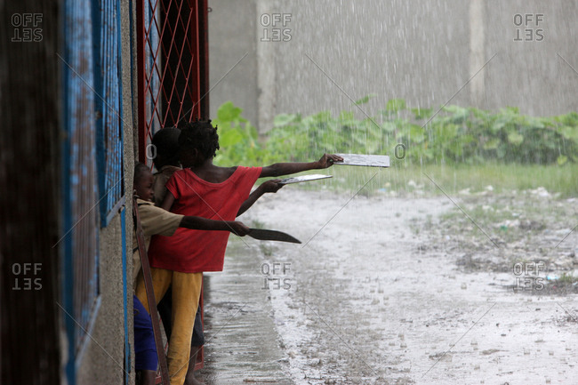 January 31, 2011: African schoolboy in the rain.