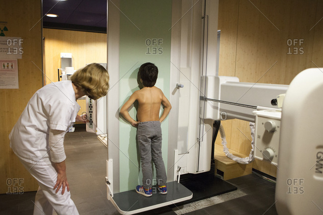 October 12, 2016: Reportage in a radiology center in Haute-Savoie, France. A technician positions a young patient for a pulmonary x-ray