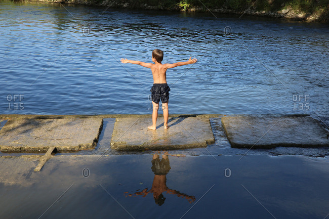 Boy Playing Riverside