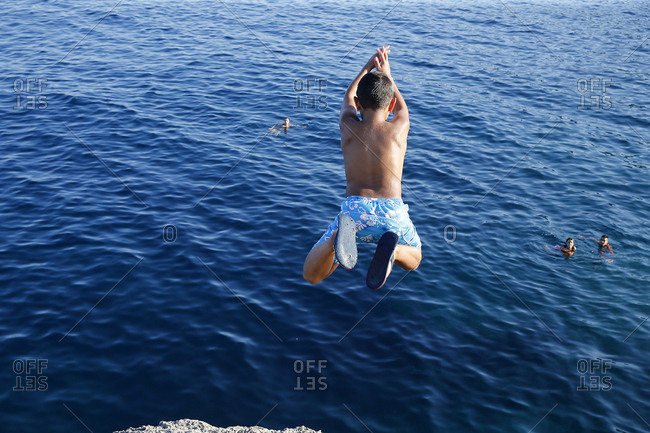 9-Year-Old Boy Diving Into the Sea