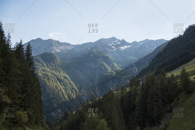 Power lines running through the Austrian Central Alps