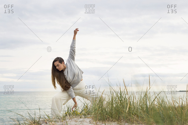 Dancer practicing on beach