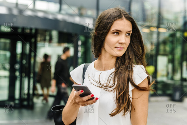 Portrait of young woman holding smart phone