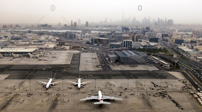 Dubai, United Arab Emirates - July 17, 2017. Overlooking Dubai International Airport with the metropolitan area and the Burj Khalifa in the horizon.