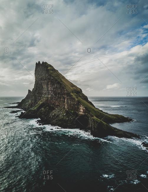 Faroe Islands - October 10, 2017: The islet Tindholmur with the five peaks in west of Vagar island.