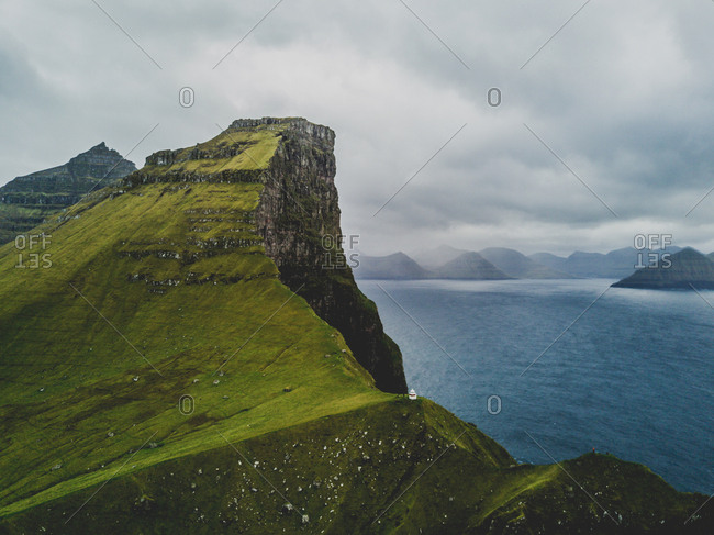 Faroe Islands - October 12, 2017: Hiking up from the Borgarin to the Kallur lighthouse, which is popular tourist destination.