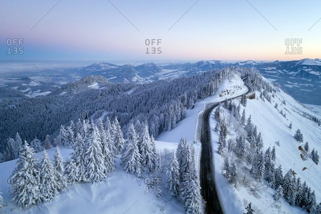 Ahornbuchsenkopf, Austria - January 10, 2017. Overlooking a mountain road and the alpine landscape of Ahornbuchsenkopf.