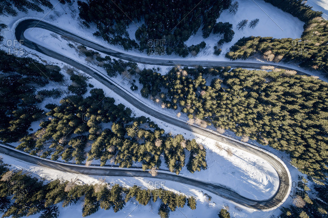Rossfeld, Germany - January 24, 2017. Overlooking the Rossfeld Panoramic Road zigzagging its way in the alpine landscape of the Berchtesgadener Land.